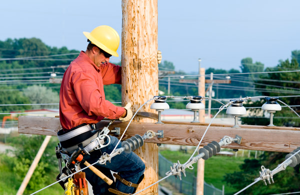 utility lineman working on telephone pole
